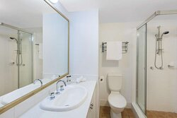 Interior view of bathroom in Two Bedroom Executive Premier Suite with shower and vanity