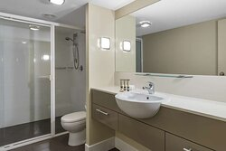 Interior view of bathroom in Two Bedroom Pool View Suite with shower and vanity