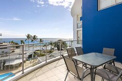 Dining area on balcony of Three Bedroom Penthouse with swimming pool and ocean view