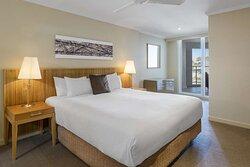 Interior view of bedroom in Two Bedroom Ocean View Suite
