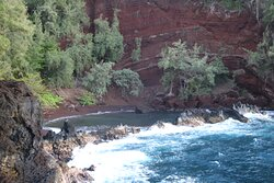 Red sand beach, viewed from the cliff trail
