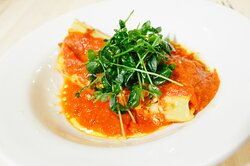 Manicotti with house marina and sunflower sprouts
