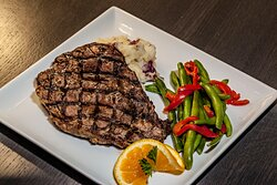 Our beautifully plated T Bone Steak with sides.