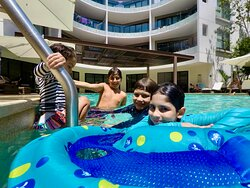 Having fun with your kids at Lagunas Mayakoba in the pool, We offer You our transfer services to & from the Cancun Airport or hotel-hotel transfers too.