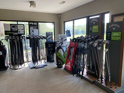 Titleist, Ping and Callaway golf club displays.