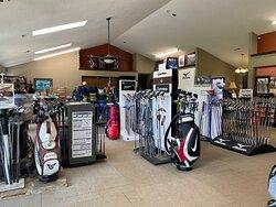 Mizuno and Taylor Made golf club displays.