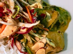 Coconut broth curried aubergine served with aromatic rice, baby spinach, crunchy slaw and almonds.
