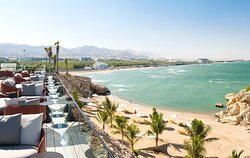 Views of the private beach and corniche from The Edge Restaurant