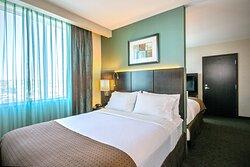 Enjoy amenities like triple sheeted, white cotton bedding.