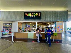 This is the Welcome Bar at Terminal #2 International by the parking/pick up area.