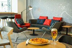 Enjoy pizza and a pint in the refurbished lounge