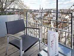 Enjoy the private balcony from the room with eiffet tower view !
