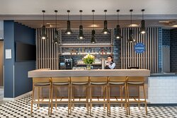 The contemporary bar offering drinks and snacks 24 hours a day.