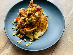 Jumbo fried soft shell blue crab, jalapeno cheddar grits, Aleppo honey, asparagus, locally foraged ramp emulsion, and sweet corn relish.