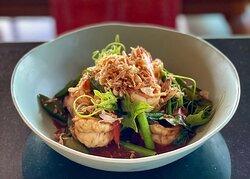 Phad Prik Phao Goong with fresh herbs and organic seasonal vegetables