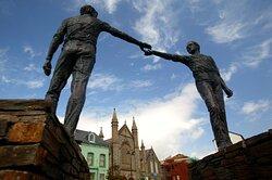 "Admire the ""Hands across the Divide"" sculpture"