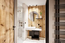 Offenes Badezimmer mit abgetrennter Dusche