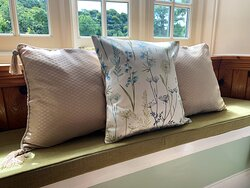 Every room has a cushioned window seat. Wisteria looks out over the Polraen Garden at Polraen Country House, Looe Cornwall