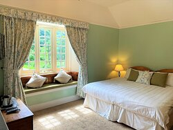 Superking room, or a twin with additional child bed available on request. Wisteria is a large sunny room with ensuite shower overlooking the Polraen Garden at Polraen Country House, Looe Cornwall