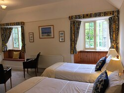 Our very large Oak room showing twin beds but can also be a superking, triple for 3 adults or a family room to sleep 4 with the addtion of two full size single beds. This lovely B&B room at Polraen Country House has an ensuite large shower room.
