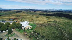 Aerial view from above the cafe, showcasing the rolling hills of the KZN midlands and the Drakensburg Mountains as a back drop.