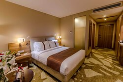 Cozy king size bed and spacious wardrobe.