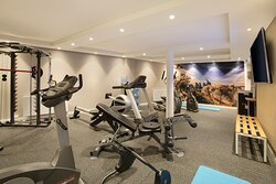 Hotel gym, open 24 hours, including cross trainer and treadmill.