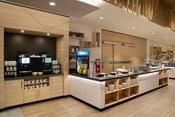 A breakfast buffet with hot and cold dishes, where kids eat free.