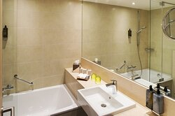 Bathroom with bathtub and amenities of an Executive Bed Room