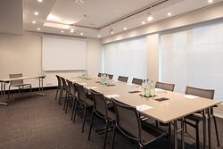 A bright, flexible meeting room available to business guests.