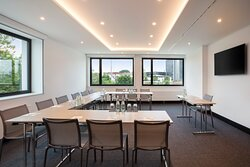 One of 8 well-equipped meeting rooms with natural light.