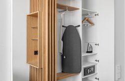 An accessible room featuring handy ironing equipment and a safe.