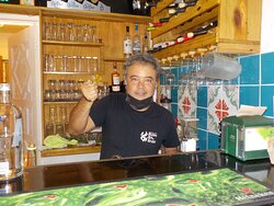 Artist/bartender/restaurant owner with our glass turtle.