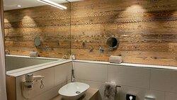 Bathroom in a very nice style, stone floor.