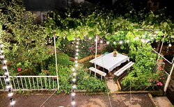 one of our garden areas with table and beautiful lights, amazing places for evening times.