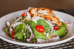 Balsamic Chicken Salad.  Grilled chicken, baby spinach, goat cheese, tomatoes, red onions, roasted pine nuts, balsamic vinaigrette.