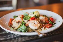 Terra Mare.  Jumbo shrimp, fresh spinach, tomatoes, mushrooms, lemon butter, capellini pasta.    A house favorite!!!!