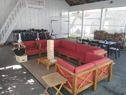 Covered outdoor seating area with Jenga and Connect Four Games.