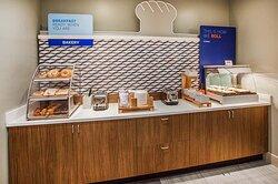 Bakery goods & Fresh HOT Signature Cinnamon Rolls for breakfast!