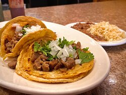 Steak tacos with beans and rice. This is the taco platter.