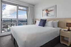 Interior view of bedroom in Two Bedroom Suite with harbour view