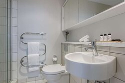 Interior view of bathroom in Studio Room with shower and vanity