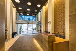 Interior view of reception area in lobby with concierge desk