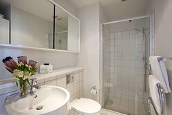 Interior view of bathroom in One Bedroom Suite with shower and vanity