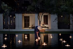 Garden and illuminated floating candles at the lobby
