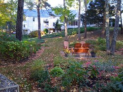 This is a view from the walking trail, showing a quiet sitting area and the inn in the background.