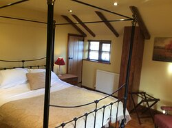 another view of four poster room in holiday cottage