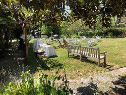 Setting up for the wedding. Beautiful landscaping with mini mini different kinds of flowers. Perfect for a cute little wedding.