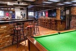 Dugout Sports Bar which has pool table, darts board which also has large screens tv's  which we show all major sports games  and have Sky Sports and BT Sports