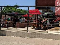 Sun umbrella dining at The Eastside Tavern.